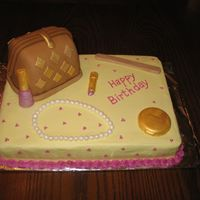 Purse Pearls Make-Up   11x15 sheet cake with fondant covered purse cake, fondant pearls and chocolate make-up