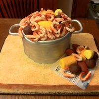 "Shrimp Boil  This was a 10"" round three-layer cake covered in MMF with MMF shrimp, corn-on-the-cob, sausage, potatoes and lemon slices. This was on..."