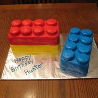 "Lego Cake For the double stack of legos I took a 10"" square cake and cut it in half and stacked one on half on top of the other. The blue lego..."