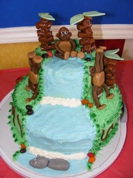 Monkey Cake I made this cake for my son's 7th birthday. The top layer was chocolate. The bottom layer was french vanilla with oreo filling, yum!...