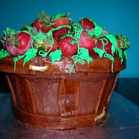 Barrel Of Strawberries 3 Tiers of yellow cake with strawberry filling and bananas. Fudge BC on outside and barrel is fondant. Top is real berries with green icing...