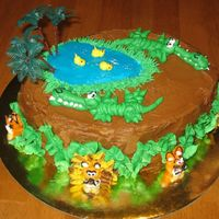 Lions, Tigers, Bears - Oh My! (And Some Crocodiles Too!) This is my first attempt in doing figure piping with buttercream.. at first I wasnt sure whether they look like lions, tigers, bears or...