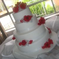Red Roses Wedding Cake Here's my first attempt at doing a wedding cake. It's my sister's wedding cake. I suppose this is one of the reason why I...
