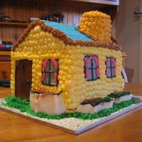 Little Yellow Cottage   This is my first attempt at a 3D cake. Made with buttercream.