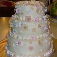 Flowers I made this cake for a baptism, it is vanilla cake with chocolate ganache & raspberry filling.