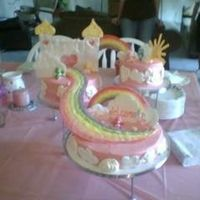 Care Bear Heaven care bear baby shower cake. the care bears came out of a quarter machine. clouds rainbow sun and castle were all color flow cream cheese...