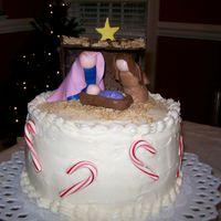 Jesus Birthday Cake With Candy Canes 2 layer 8 inch white cake iced with crusting cream cheese icing and fondant nativity scene; crushed mini wheat cereal for straw; candy...