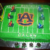 Auburn Football Cake Yellow sheet cake frosted with crusting buttercream icing.