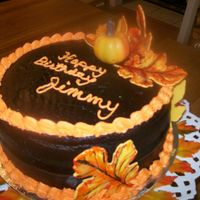 Fall Birthday Cake Killer Chocolate Cake (CC recipe) frosted with Walter's Crusting Chocolate Fudge Icing (CC recipe). The leaves are yellow fondant and...