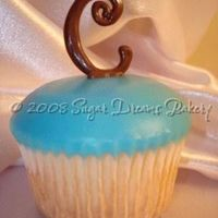 Monogram Cupcakes This was one of two dozen monogram cupcakes for a baby shower! WASC cake with poured fondant and chocolate monograms! Pretty easy to make,...