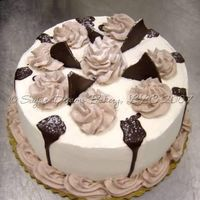 Ebony & Ivory Cake I loved making this cake! It's 4-layers alternating between vanilla and chocolate. The vanilla layers have vanilla whipped topping and...