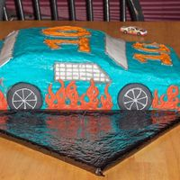 Ethans Race Car Basic butter cake with crusting cream cheese icing. first carved cake ever!!!! was very nervous next time i wont be so scared to carve the...