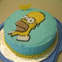 Happy Homer Day This was my first cake that I made at lesson 2 of Level 1 Wilton's class.I definitely need to work on the main icing, getting it...