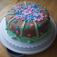 Spring Flowers I did this cake for my parents since both their birthdays are in May, as is their anniversary. Since I was leaving the state on such short...