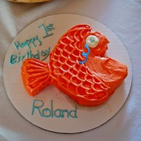 Goldfish Smash Cake This is the Goldfish smash cake for my son's first birthday. Carrot cake with cream cheese frosting tinted in two shades of orange....
