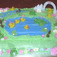 Frogs & Ducks Decorations are all fondant and royal icing. The grass and pond are buttercream icing.