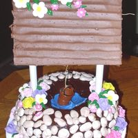 Wishing Well  I copied most of this one from another cake posted on this site by auntiecake. She makes the most beautiful cakes! I have most of her cake...