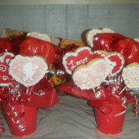 Valentine Day Cookie Bouquets sugar cookies iced with Alice's delicious icing recipe. fondant cherubs on some cookies. Also some are chocolate chip heart cookies,...