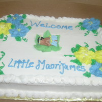 Hawiian Luau Baby Shower Cake this is a strawberry cake with buttercream icing. the baby is made from a first impression mold using gumpaste. with gumpaste skirt and...