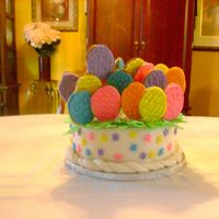 Easter Basket Cake This is a easter basket cake. I made the handle. but the handle broke apart. The cake is a yellow cake with strawberry filling. iced in BC...