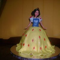 Snow White Doll Cake This cake is white cake for the skirt part and yellow cake for the 9 inch round layer underneath to give it more height because the doll is...