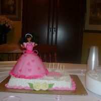 Granddaughter's 5 Year Old Birthday Cake The bottom cake is strawberry with buttercream icing and gumpaste flowers. The doll cake is chocolate cake with mmf covering her bodice and...