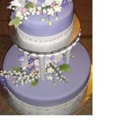 Lily Of The Valley And Violets For Diane Gumpaste lily of the valley, violets and fantasy flowers are the main flowers on this lilac fondant covered wedding cake.