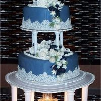 True Blue Lov 3 Tiers of blue fondant covered heart shaped cakes. Decorations include over 60 white roses, navy orchids, light blue for-grt-mr-nots, and...