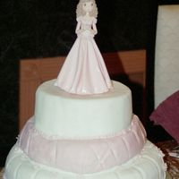 "Mady's 15 Cake Yellow cake with ""dulce leche flavor"" covered in pink and white fondant."