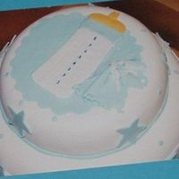 Boy Baby Shower yellow cake with dulce leche filling to resemble the invitation. fondant covered with all details made out of fondant.