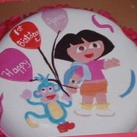 Dora The Explorer yellow cake with heath bar covered in fondant. figures are made from fondant.