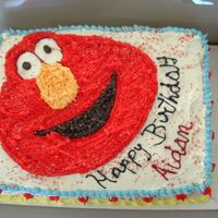 Elmo Birthday Cake White cake with strawberry filling. Buttercream frosting. Buttercream Elmo.