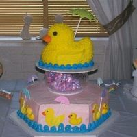 It's Raining Baby Ducks!!! Made this cake for my daughter's baby shower. Ducks are fondant/buttercream, icing is buttercream on big duck and cake.