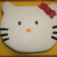 Hello Kitty Birthday Hello kitty cut from 1/2 sheet cake. Used corners of cake to make ears, just put a skewer through them and glued them on with buttercream....