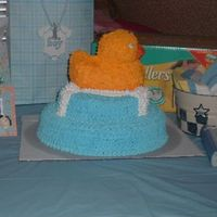 2006_0716Puppies7-12-060105.jpg Rubber ducky shower cake. Sorry... last minute and forgot to put something under the cake other than the board. hee hee