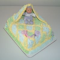 Baby Shower Cake By Pastry Chef Victor Kline  This was so much fun to make. The Blanket is wax paper covered in white whipped. To view more of my cakes please go to my web site myspace...