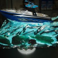 Grooms Boat Cake By Kline's With Pulled Sugar   This is a grooms cake made with pulled sugar for the waves.. Please let me know what you think...Made by Pastry Chef Victor Kline