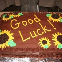 Good Luck! Chocolate cake with chocolate BC icing. Sunflowers are also made out of BC icing.