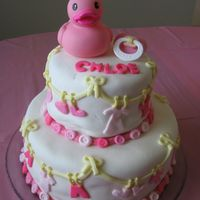Baby Shower Cake This cake is based on a cake out of the Wilton Yearbook 2006. I used MMF (but it is quite bubbly since it's been so long since I'...