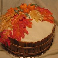 Fall Pumpkin Spice cake / Cream cheese icing. Recipe from Cake Central recipes. The leaves are white chocolate painted with Pearl dust.