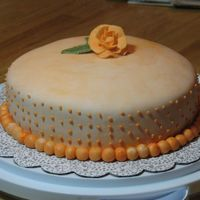 Mmf THis is my first attempt at MMF- I added leftover orange Jello mix to it. The cake is orange flavor with orange buttercream. My 'dots...