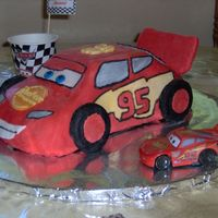 Lightning Mcqueen Cars Movie  I made this for my son's birthday. It was made from the 3D cruiser pan and decorated with fondant. The spoiler in the back was...