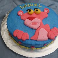 Pink Panther The cake is covered in buttercream and Pink Panther is made from fondant.