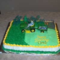 John Deere Lawn Mower  11 x 15 cake decorated with cream cheese icing (from this web site). I cut out a picture of my dad and grandchildren and attached them to...