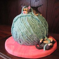 Kittens And Ball Of Yarn This cake is supposed to be made in all fondant but because the people I was making it for didn't like it I made it with BC. I think...