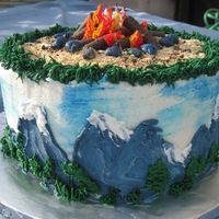Campfire/mountain  This was a birthday cake. It's all BC. The logs were cookies. I inserted a few color-flamed candles in the center of the fire and when...