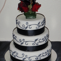 Simple Elegance This is a simple yet elegant wedding cake I was asked to do. All tiers are covered in fondant, with royal icing scroll work, satin ribbon...