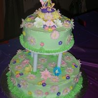 Tinkerbell This cake I did for a special little girl who loves Tinkerbell. The cake is covered in buttercream and the flowers are gumpaste and royal...