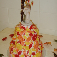 Fall Florals This colourful fall wedding cake is covered in fondant, gum paste leaves and daisy's all covered in luster dust. Thanks for looking!