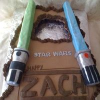 Zachary's 8Th Birthday Cupcake Cake for my sons 8th birthday. Light Sabers made out of RKT and covered in fondant.